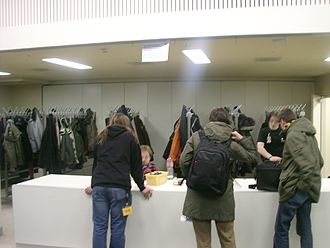 Gratuity - Coat check staff are usually tipped for their service and this photo shows a coat-check area at the Berliner Congress Centrum (BCC) in Alexanderplatz, Berlin, Germany