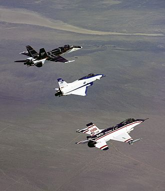 Three experimental thrust vectoring aircraft in flight; from left to right, F-18 HARV, X-31, and F-16 MATV 3 three thrust-vectoring aircraft.jpg