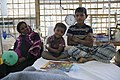 4-year-old Anowar pictured with his mum and brother after being treated for diphtheria by the UK's Emergency Medical Team in Kutupalong, Bangladesh (28040394749).jpg