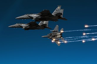 4th Operations Group - F-15E Strike Eagle aircraft from the 335th Fighter Squadron releases flares during a local training mission over North Carolina, 17 December 2010.