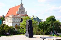 Lublin Holocaust Memorial, with the Carmelite Church in the background