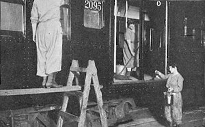 AB Standard (New York City Subway car) - Women shop workers clean and repaint an AB Standard c. 1917–1918. Women often took jobs in car shops during this time as many men were fighting in World War I.