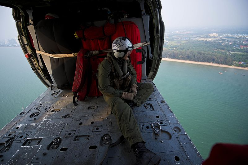 File:A Sailor aboard an MH-60S over the Gulf of Thailand. (8497228003).jpg