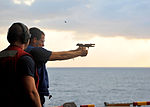A U.S. Sailor aboard the amphibious assault ship USS Boxer (LHD 4) fires a 9 mm pistol during a small-arms qualification course in the Arabian Sea Jan. 2, 2014 140102-N-PZ713-229.jpg