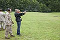 A business leader attending a Marine Corps Executive Forum (MCEF) fires an M9 Beretta pistol at a target under the supervision of a U.S. Marine aboard Marine Corps Base Quantico, Va., July 11, 2013 130711-M-MI461-282.jpg