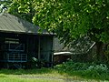 A close-up view of an old farm with barn of wave-plate; The Netherlands 2012.jpg