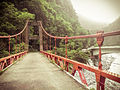 A red suspension bridge in Taroko Gorge (12609732185).jpg