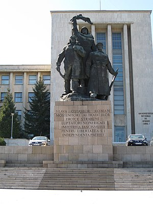 "Carol I National Defence University - Statue facing entrance. Inscription reads: ""Glory to the Romanian troops, inheritors of ancient heroic traditions, undaunted fighters against fascism for the fatherland's liberty and independence""."