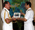 Admiral Robin K. Dhowan and Royal Navy Admiral George Zambellas exchanging mementos after holding discussions.JPG