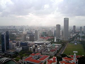 Padang, Singapore - An aerial view of Singapore, showing the Padang on the right, surrounded by Parliament House building, new and old Supreme Court Buildings and Swissôtel The Stamford.
