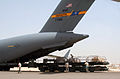 Air Transportation Airmen From the 380th Expeditionary Logistics Readiness Squadron's Air Terminal Operations Center Drives a 60,000-pound-capable Aircraft Loader to Unload a Plane During Operations DVIDS290903.jpg