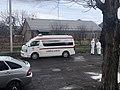 Ambulance car and Health workers.jpg