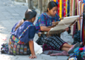 Amerindian women from guatemala working in textiles.png