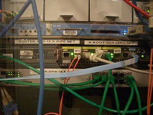 Root name server - A Cisco 7301 router and a Juniper M7i, part of the K root-server instance at AMS-IX.