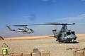 An AH-1W Super Cobra helicopter flies past a UH-1Y Venom helicopter at Forward Operating Base Edinburgh, Helmand province, Afghanistan, Jan 120101-M-UC900-053.jpg