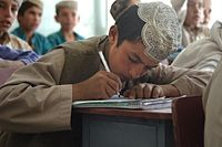 An Afghan student takes copious notes.jpg