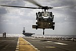 An MH-60S Seahawk takes off from the flight of USS Iwo Jima. (30162868562).jpg