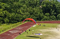 An assisted para glider about to land in Resithang ground, Sikkim.jpg