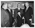 An unidentified boy shakes hands with Mayor John F. Collins as Lenahan O'Connell, esp., Erwin Canham and Augustin Parker watch (12306245145).jpg