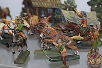 Antique toy cowboys and indians (25202848391).jpg