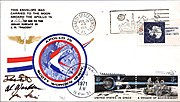 "A rectangle with the headline ""An Apollo 15 Flown Lunar Postal Cover"" with a logo in the middle. Below it are two smaller frames. One has some text certifying that what was below was flown to the moon and back, signed by flight commander David Scott. Below it is an envelope with stamps, logos and postmarks"