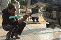 Army Spc. Tiffany Robertson washing a truck.jpg