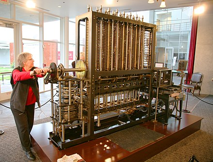 A difference engine: computing the solution to a polynomial function Babbage Difference Engine (Being utilised).jpg