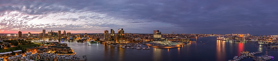 Panoramic view of Baltimore along the Inner and Outer Harbor at dusk, as seen from the HarborView Condominium.