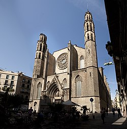 stone gothic facade with rose window and two towers
