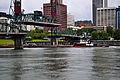 Barge passes under Hawthorne Bridge.jpg