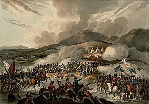 Color print showing soldiers under British flags in the foreground attacking French troops with a backdrop of mountains.