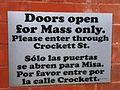 Bilingual sign at Dallas Cathedral.JPG