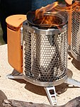 A photo of a BioLite CampStove in operation being demonstrated outdoors