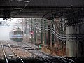 Blue Line train in the rain, November 2013.JPG
