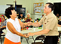 Boatswain's Mate Seaman Francisco Vazquez gets a dance lesson from a local senior during a community service project at the Yona-Talofofo Senior Citizens Center in Talofofo.jpg