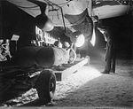 Bombing up RAF Mitchell Melsbroek WWII CL 1792.jpg