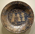 Bowl with dancing dervishes, Sultanabad ware, Iran, Ilkhanid period, first half of 14th century, earthenware with underglaze painting in blue, black, white slip - Cincinnati Art Museum - DSC04052.JPG