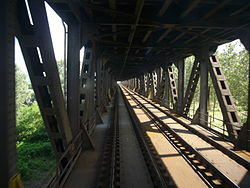 The bridge over the پو (رودخانه) on the Genoa–Milan railway at Bressana Bottarone
