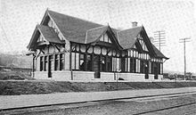 A single-story Tudor Revival railroad station