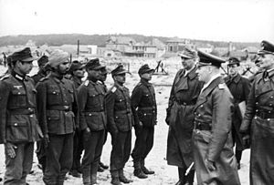 Günther Krappe - Hermann Meyer-Rabingen (right) inspecting the Indian Legion with Generalfeldmarschall Erwin Rommel (center) and Generalleutnant Günther Krappe (left).