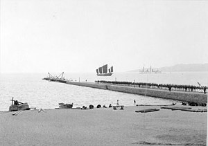 Zhan Qiao - Pier with German naval personnel, apparent expansion in progress, 1898