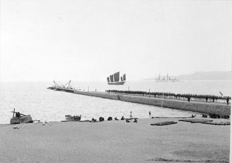 Kiautschou Bay concession - Pier with German naval personnel, apparent expansion in progress, 1898