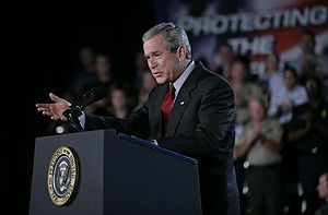 Patriot Act, Title II - President George W. Bush addresses an audience Wednesday, July 20, 2005 at the Port of Baltimore in Baltimore, Md., encouraging the renewal of provisions of the Patriot Act.