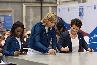 USS Enterprise (CVN-80) - Simone Biles and Katie Ledecky sign a 35-ton steel plate used to begin the construction of Enterprise