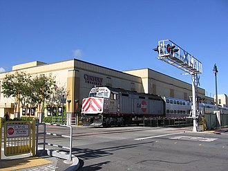 San Mateo station - Southbound Caltrain passing the present-day theater, site of the original station
