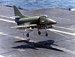 Camouflaged A-4C of VA-113 landing on USS Kitty Hawk (CVA-63) c1966.jpg
