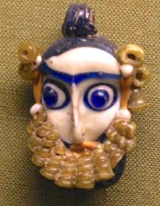 History of Carthage - 4th-3rd centuries BC Phoenician style glass pendant in the form of a head