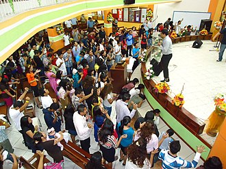 Pentecostalism - Pentecostals pray in tongues at an Assemblies of God church in Cancún, Mexico
