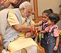 Children tying 'Rakhi' on the Prime Minister, Shri Narendra Modi's wrist, on the occasion of 'Raksha Bandhan', in New Delhi on August 29, 2015 (1).jpg