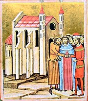 A crowned man and a man wearing a hat shake hands before a priest at a church